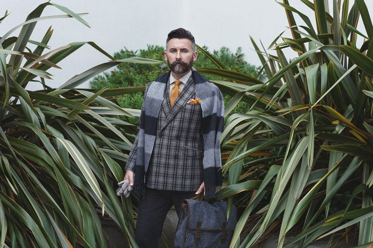 The Modern Gentleman - Tom wears the Julian jacket in grey wool flannel, grey Barrington cords and the Charlie shirt with an angora wool scarf, golden silk knitted tie and floral cotton pocket square.