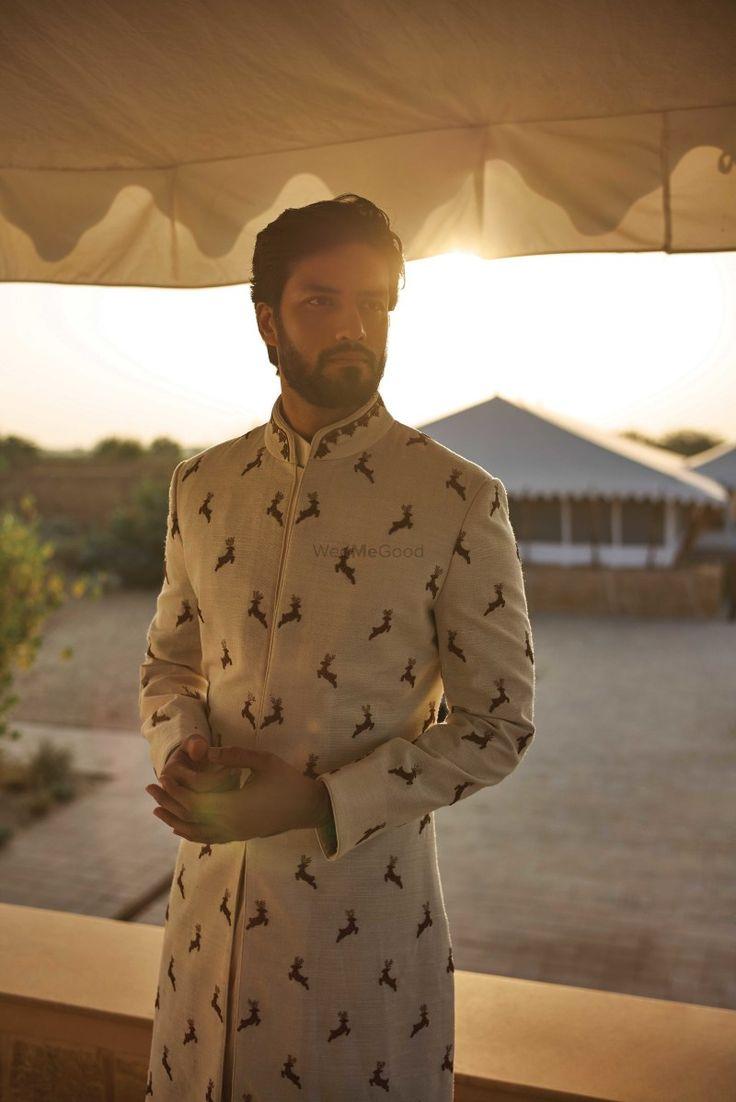 Ivory sherwani with bird motifs for the groom to be | WedMeGood| #wedmegood #indianweddings #ivory #sherwani #birdmotifs #groomswear #pastel #weddingwear