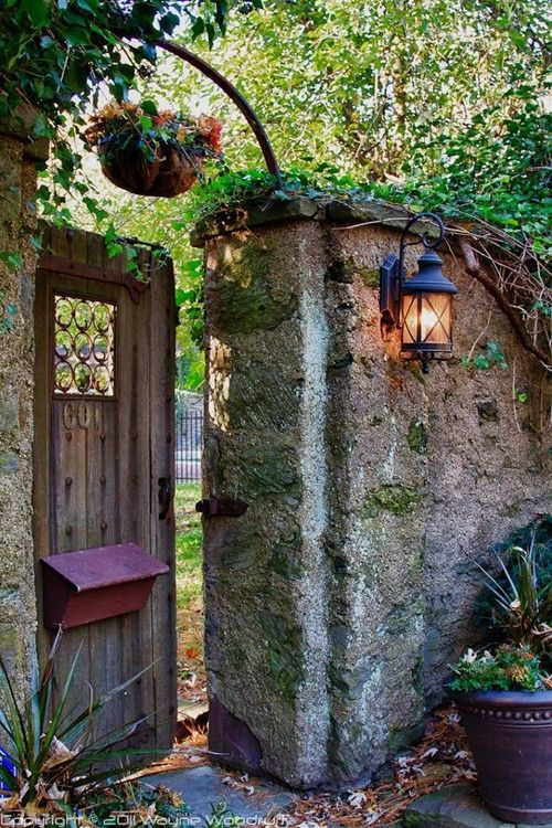 Garden door with small window to look through--to identify visitors, and entice passersby...