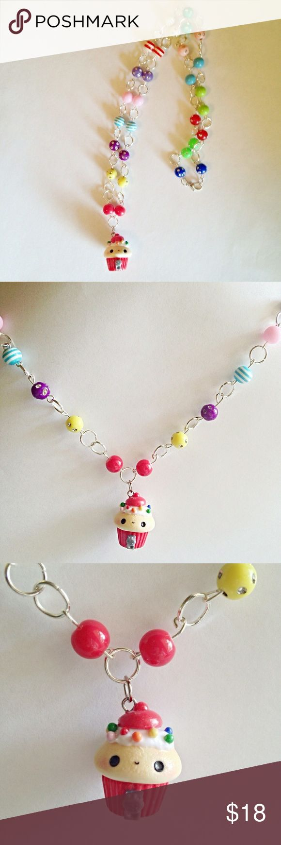 Handcrafted Kawaii Bubble Gum Machine Necklace This is an adorable Kawaii Polymer Clay Bubble Gum Machine Cupcake Beaded Link Necklace! What a perfect gift for that special child! This necklace measures a little over 12-inches in length and features a cute kawaii polymer clay multi-colored bubble gum machine cupcake charm. The necklace is dressed in multi-colored beads, such as red, blue, green, yellow, etc. bling rhinestone beads. In addition to the bling beads, several swirl and…