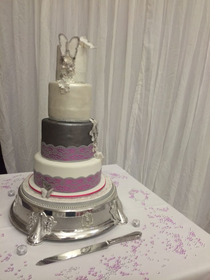 4 tier lace butterflies pink pearl silver and white cake