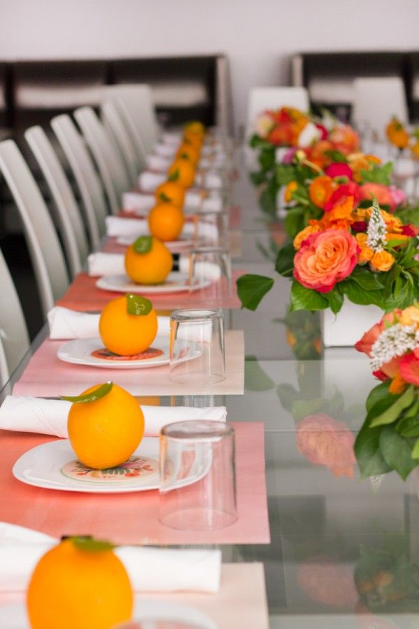 Pin paper leaves into oranges as place settings