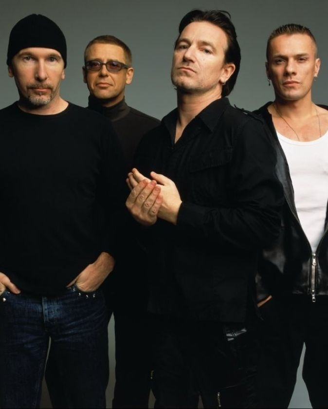 U2  I absolutely LOVE this picture because it's rare to see Bono without his shades on.