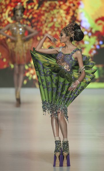~~  Guo Pei A model showcases designs by Guo Pei of China on the catwalk during the Hong Kong Fashion Extravaganza 2010