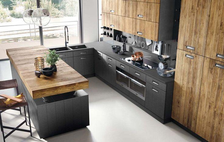 La cucina componibile contemporanea Lab 40 di Marchi Cucine in stile moderno industrial è una cucina angolare con penisola, caratterizzata dalla grande cappa, lavabo in pietra e rubinetteria Stella.