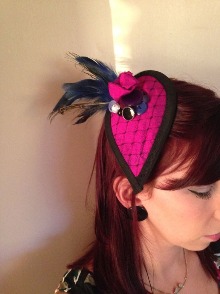 The Burlesque:  Fuchsia pink silk fascinator with merry widow's veil detail, silk rose, buttons, peacock and cobalt blue rooster feathers by DollsMadHattery on Etsy https://www.etsy.com/listing/201802897/the-burlesque-fuchsia-pink-silk