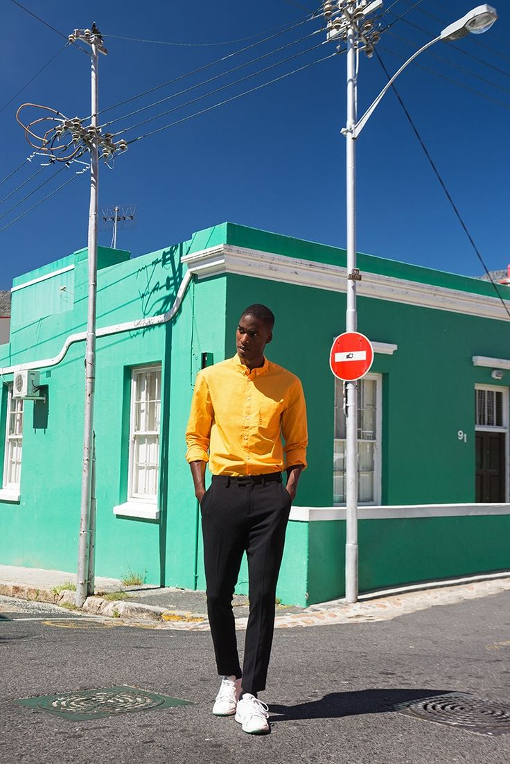 Gauderic wears orange shirt Hugo Boss, trousers Paul Smith, and shoes Prince.