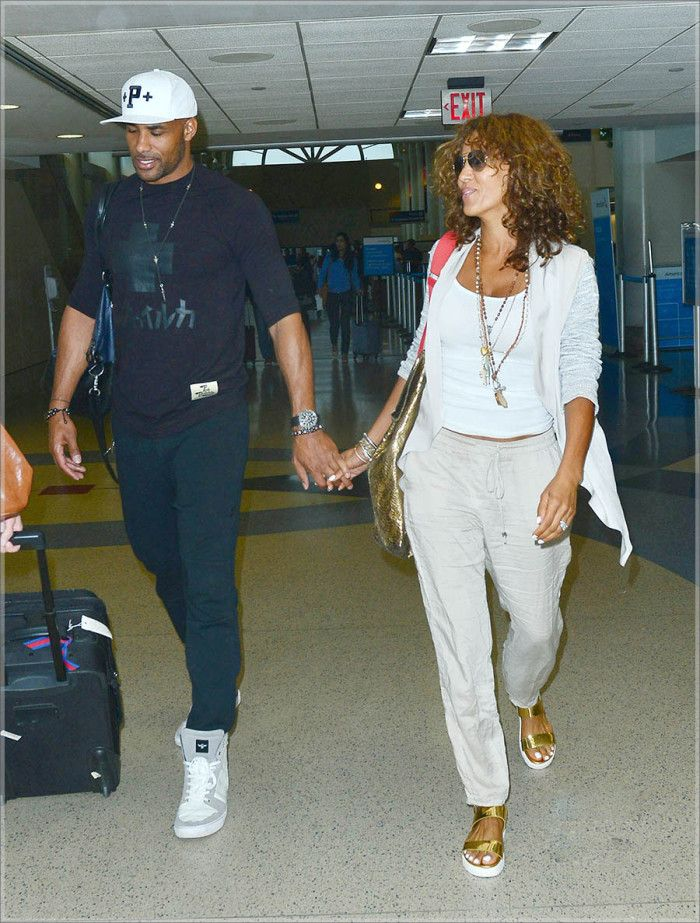 Cute couple Nicole Ari Parker and Boris Kudjoe were spied at LAX Airport in Los Angeles.