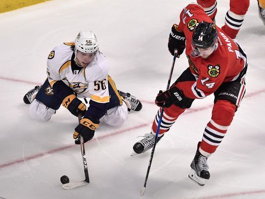 Nashville Predators left wing Kevin Fiala (56) moves the puck defended by Chicago Blackhawks right wing Richard Panik (14) in the third period of game two in the first-round NHL playoff series at the United Center, Saturday, April 15, 2017, in Chicago, Ill.  Andrew Nelles / The Tennessean