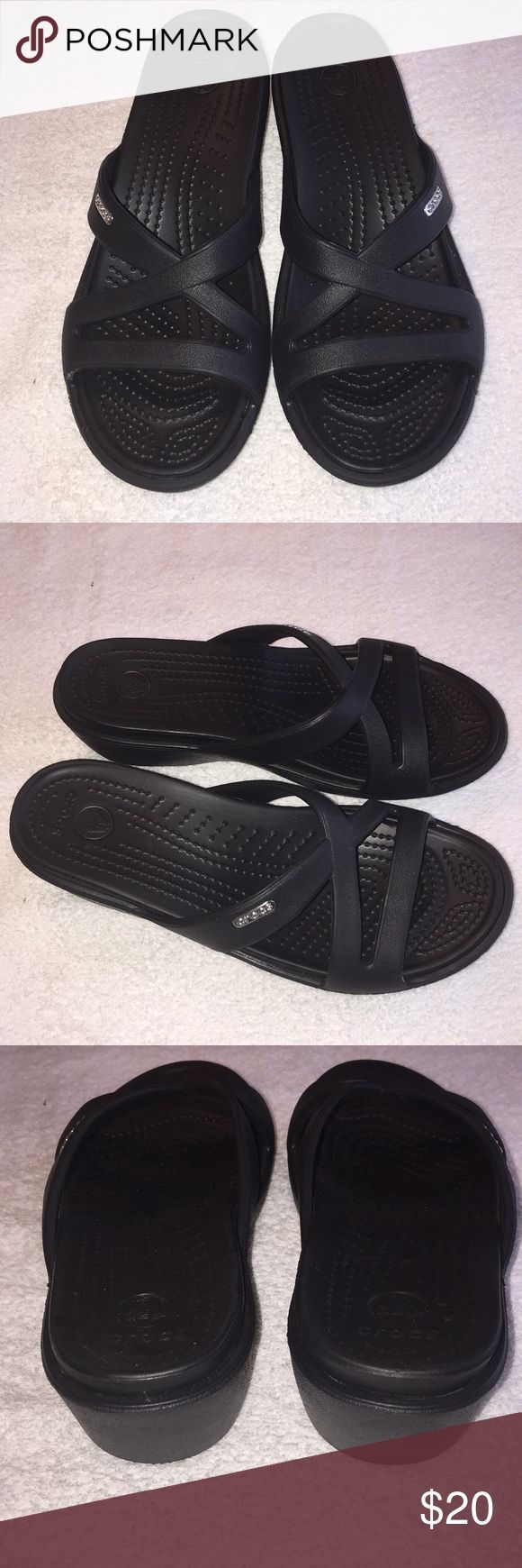 Women's Crocs brand sandals size 7. This is a pair of women's Crocs brand sandals size 7. They have been worn only a few times and are in good shape. They are black in color. If you have any questions please let me. Thanks! Shoes Sandals
