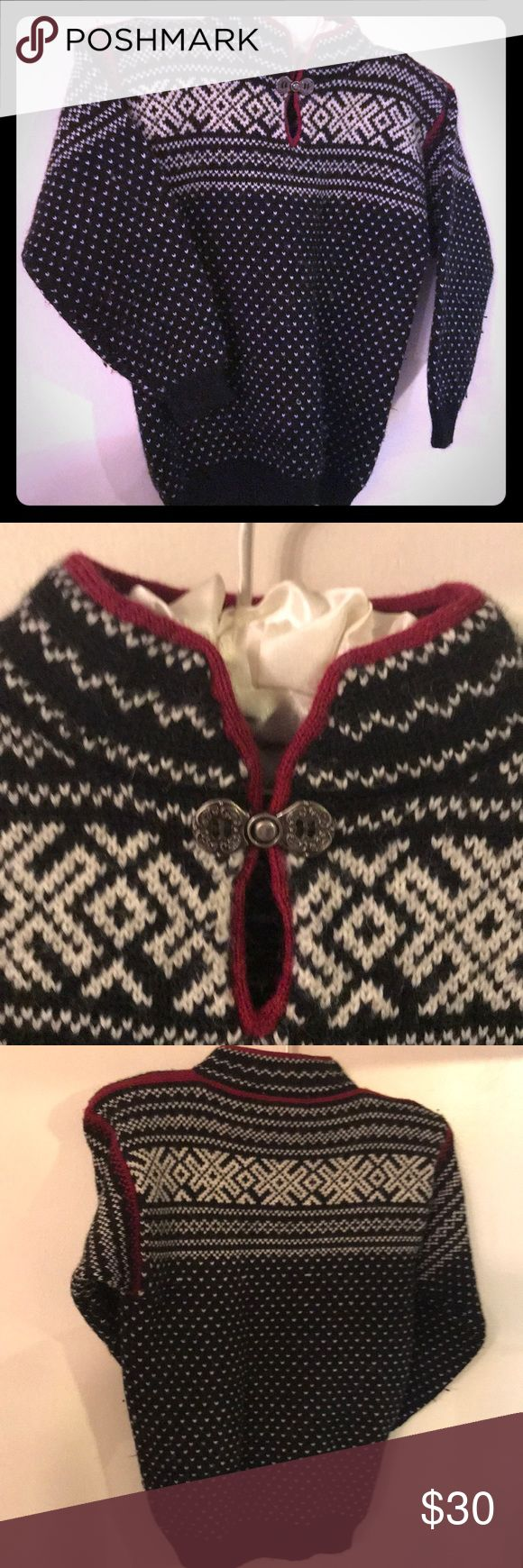 """Kids apres ski sweater Stunning """"Little Nomad Norwich Vermont"""" cozy sweater. Dress for the slopes even if you're not going. This trendy sweater is  black with white winter pattering and red trim. A beautiful silver clasp above a peekaboo opening makes this top even more stylish. Worn maybe once. Small amount of pilling due to the nature of the wool fabric. Little Nomad Shirts & Tops Sweaters"""