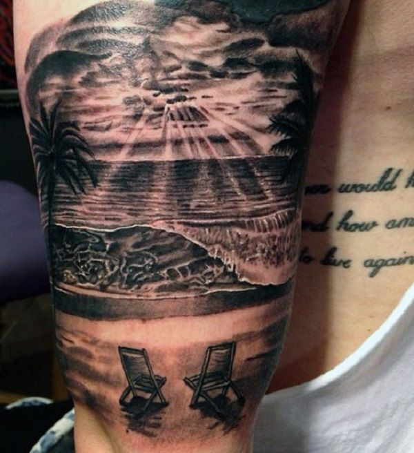 Another grayscale beach tattoo design showing two wooden chairs on the shore facing the beach waves as the sun is slowly rising from the clouds.