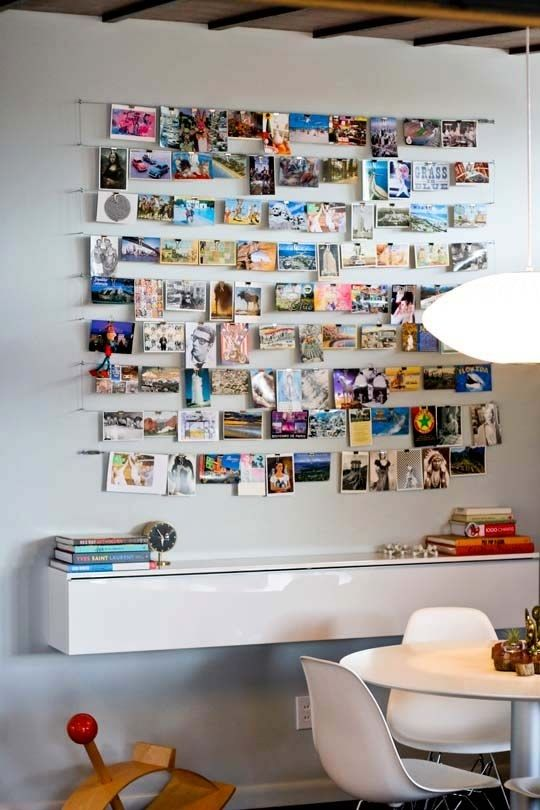 Create a display for your favorite photos with binder clips and wire.