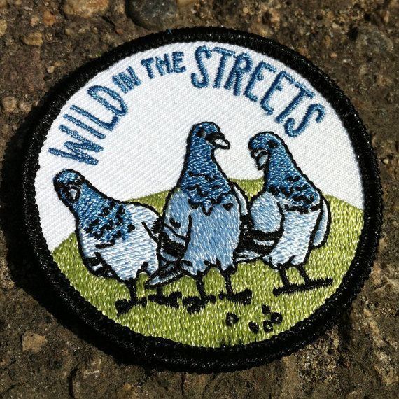 2.5 Round Iron-On Embroidered Patch -Wild In The Streets -Bad things come in threes. This time its some shifty eyed pigeons.