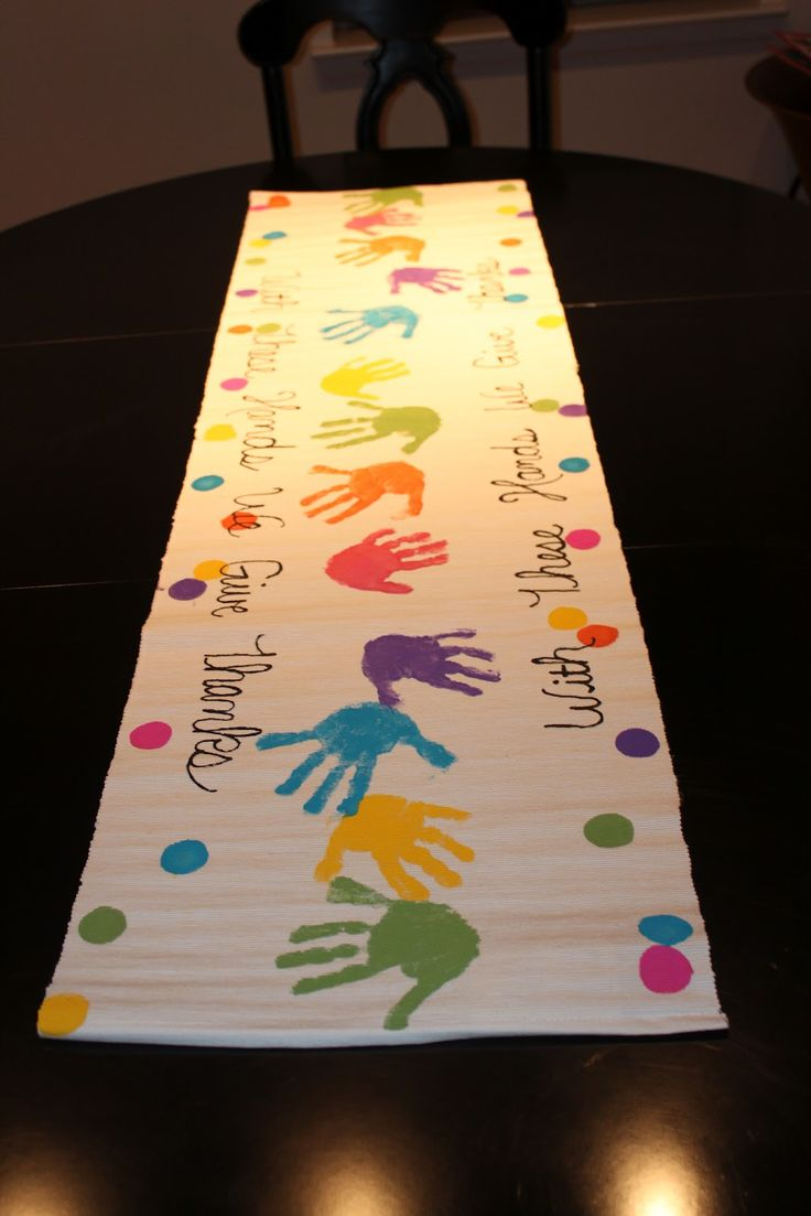 """with these hands we give thanks"" table runner...maybe good for anniversary celebration table runner and flowers in glass bottles with various colors of paint coated on inside to coordinate"