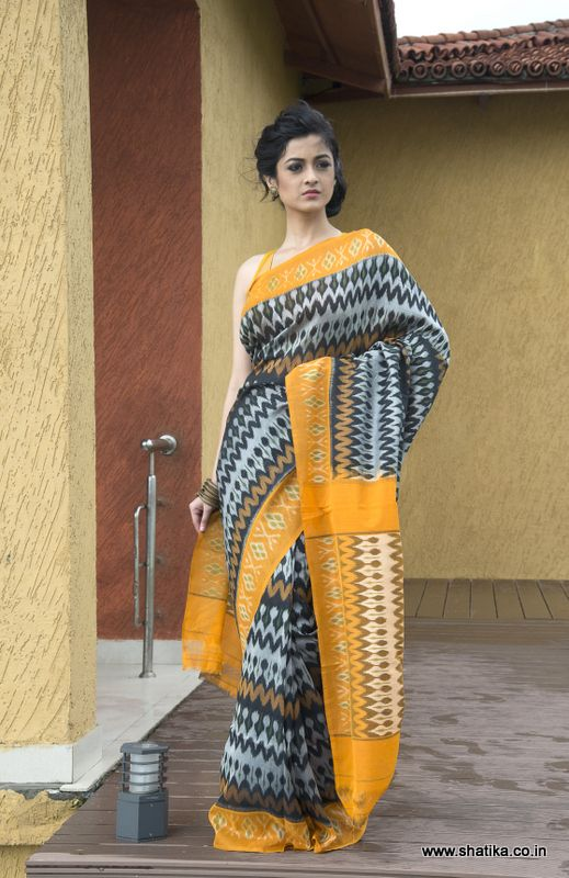 Unique with a rare colour combine, this perfect hand woven Pochampally cotton saree is custom made to suit the needs of the modern Indian woman. Traditional geometric and zig-zag designs of the Pochampally school complement the yellow border. The distinctive pallu beautifully picks out and enhances the colour blend of this ikat dyed saree. Make this Sasha Double Ikat Pochampally Cotton Saree yours to stand out from the rest!