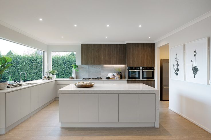 Open plan contrasting kitchen with Caribbean World of Style on display in the Charlton 33.