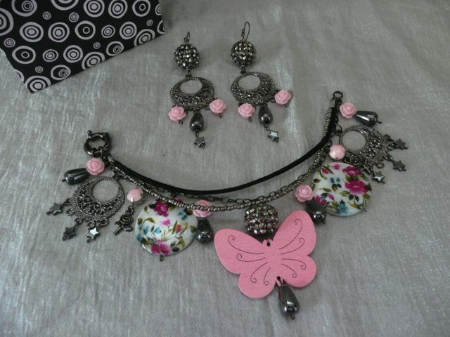 Theme: Oh I wish I was a punk rocker with flowers in my hair. Or the shorter version - Pretty in Punk! This one took the win for the month. There was a lot of work in it because I only had gunmetal grey eye pins and had to make little head pins out of them. I wanted to include more strands and bulk in the bracelet but ran out of time. It still came out pretty good (and I won!).