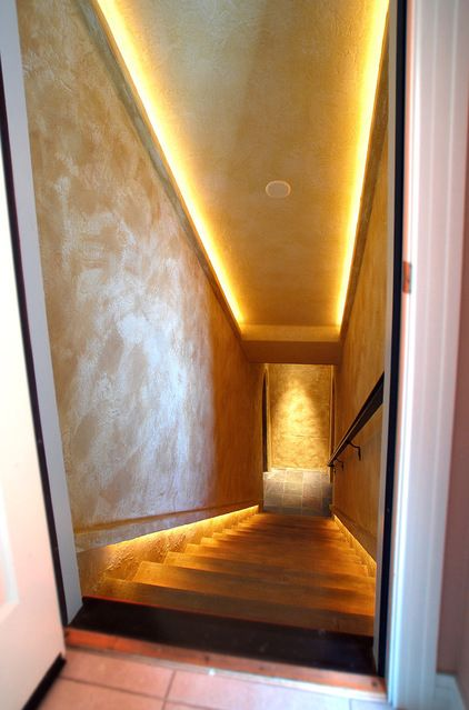 Cool solution for the stairway to the media area of the basement. Strip lighting! Look at the other photos in this series. It's a basement renovation to a beautiful wine cellar.