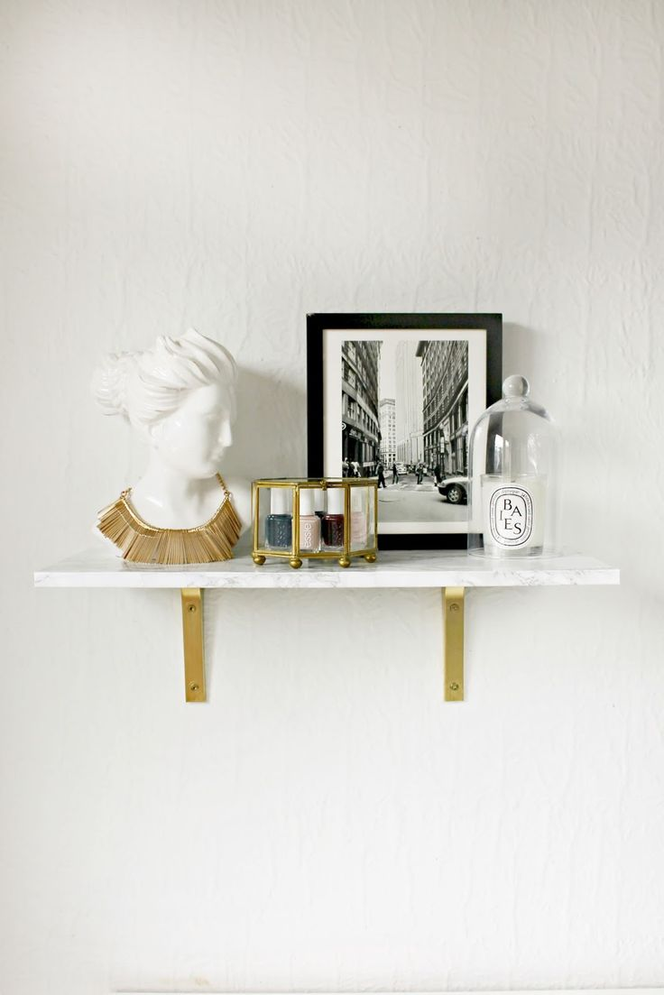 I have long been lusting over this Marble Wall Mounted Shelf from CB2. Isn't it fabulous? Who doesn't love a good marble / gold /  functional element for your home?  I knew I could DIY an almost identical version, so I created a tutorial for my latest eHow Post! I'm in love with the outcome, and it was...Continue Reading