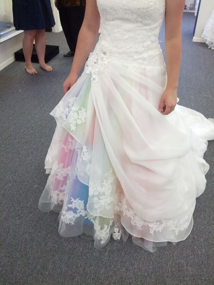 Kesslan was having a rainbow-themed wedding and asked us to add some detail to her dress - this is what we came up with! Congratulations Kesslan!