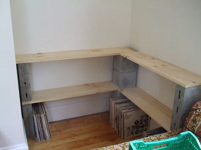 DIY custom record shelves: Never underestimate the efficacy of good ol' cinder blocks and pine boards - especially if you've got a small odd-shaped area to work with. This unused corner area was converted to a record station for a mere $30.