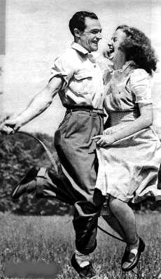 Gene Kelly and Betsy Blair, married 1941-1957 (divorced). Great candid photo.