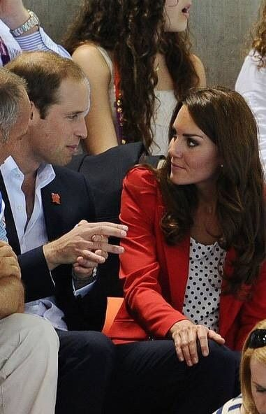 Kate with her hand on William leg, how cute: