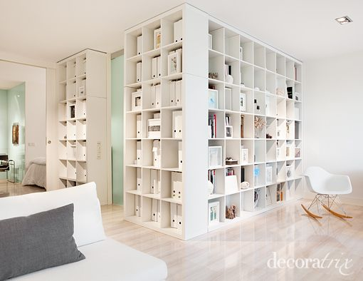 using bookshelves as room dividers, storage is everything in small spaces!