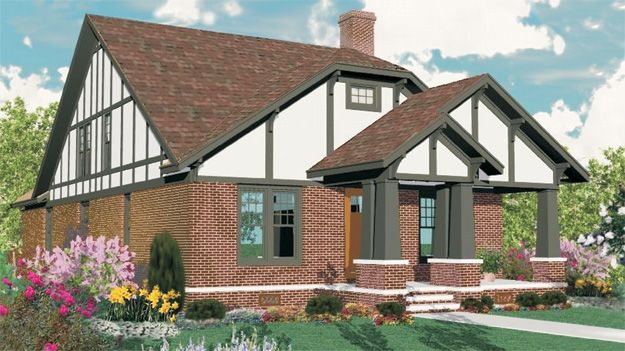 Cozy brick tudor home plan with columns accentuating the for Victorian tudor suite