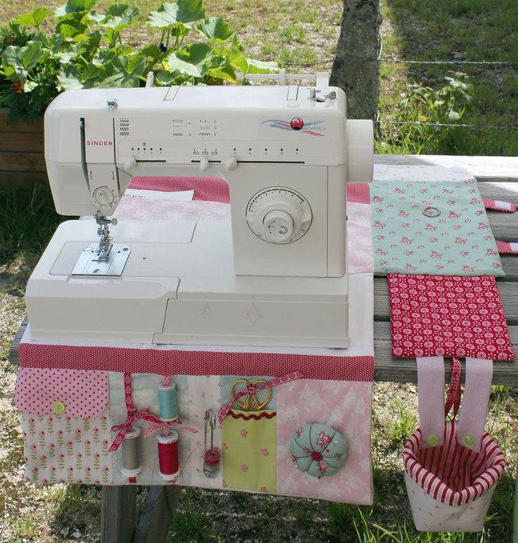 excellent idea. make a table cloth for under your sewing machine that has a drop side with pockets to fit your most used accessories
