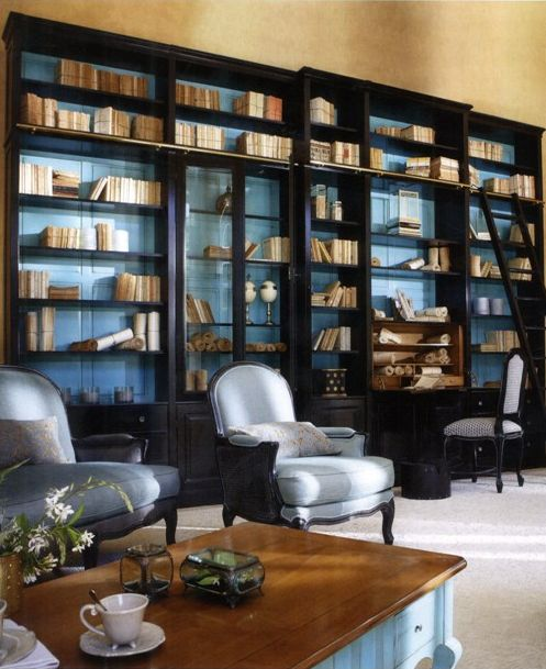 still unsure, but this makes me reconsider painting the back of the dark bookshelves - it's surprisingly sophisticated here