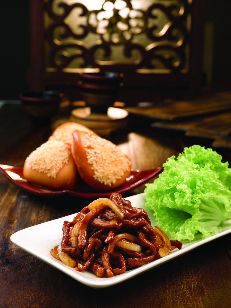 Shredded meat with bun - Shredded pork with sweet onions tucked into handmade crispy golden buns topped with sesame seeds. Heartily satisfying and delicious. A must-try.
