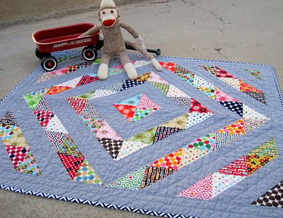 Amy Gibson's Prism Baby Quilt from her blog: stitcherydickorydock. Adorable!