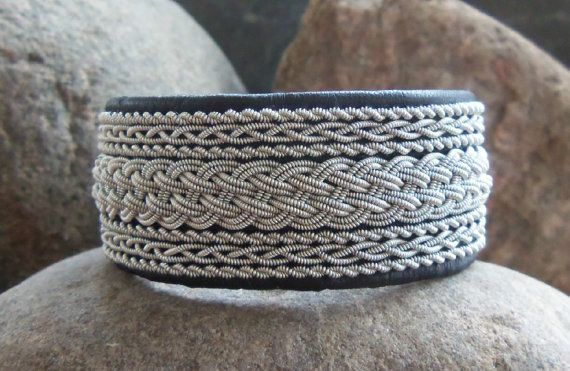 Wide Sami bracelet with black reindeer leather and pewter wire