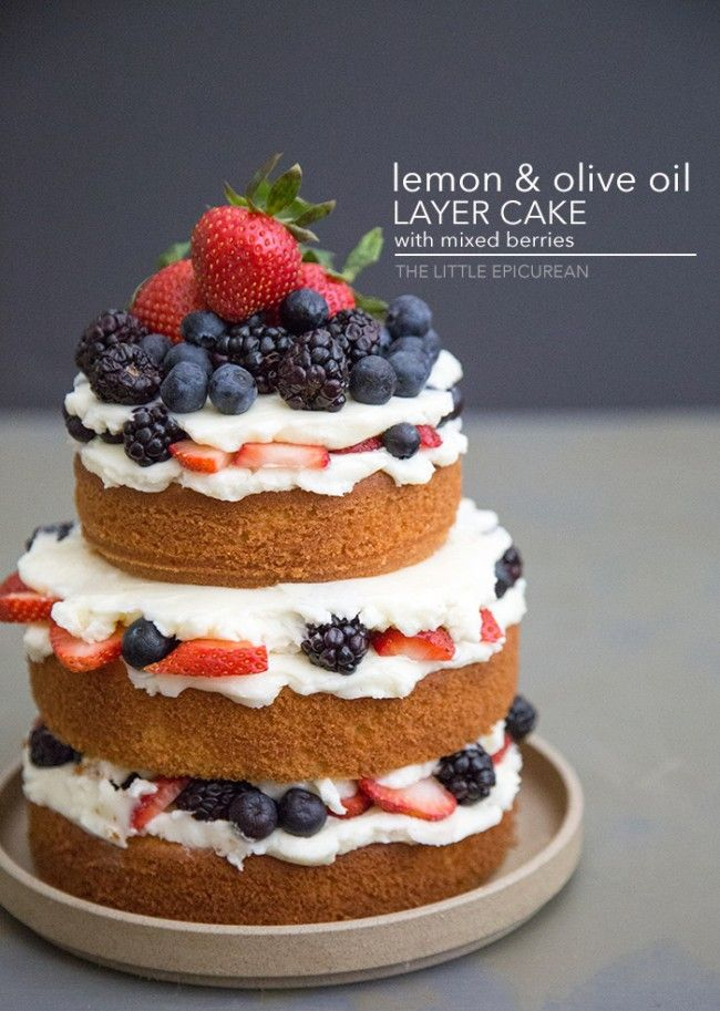 Lemon Olive Oil Layer Cake: 1 3/4 cup all purpose flour, 2 tsp baking powder, 1/2 tsp fine sea salt, 1/2 cup unsalted butter, melted, 3/4 cup extra-virgin olive oil, 1/4 cup whole milk, 4 large eggs, room temperature, 1 cup granulated sugar, zest of half lemon, fresh berries, as needed. Swiss Buttercream: 6 large egg whites (about 1 cup), 1 1/2 cup granulated sugar, 1 pound (2 cups) unsalted butter, cut into tablespoons, softened, pinch of salt