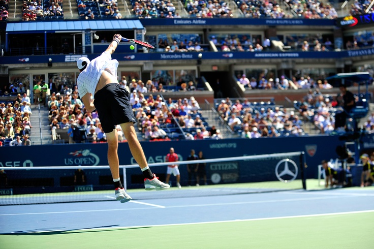 Xavier Malisse (BEL) and John Isner (USA)[9] play in the first round of the US Open. - Andrew Ong/USTA