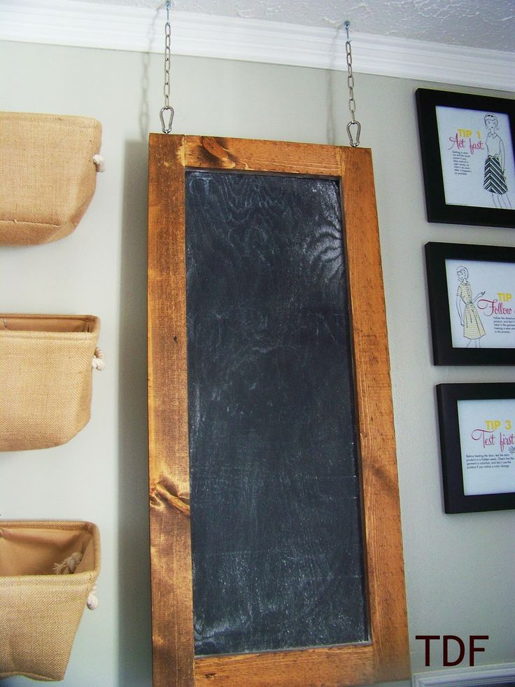 Three Dog Farmhouse  hang a chalkboard from the ceiling  to cover electrical panel