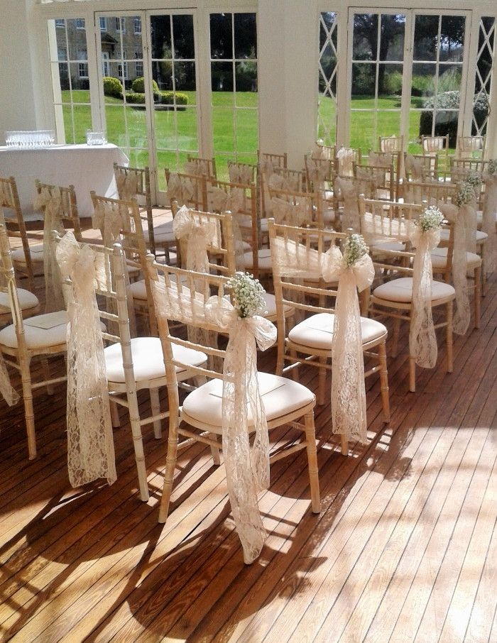 A pretty vintage themed wedding at Barton Hall this weekend. The Orangery chairs were tied with ivory lace sashes, tied on the side for the aisle end chairs and finished with sprigs of gypsophilia ...