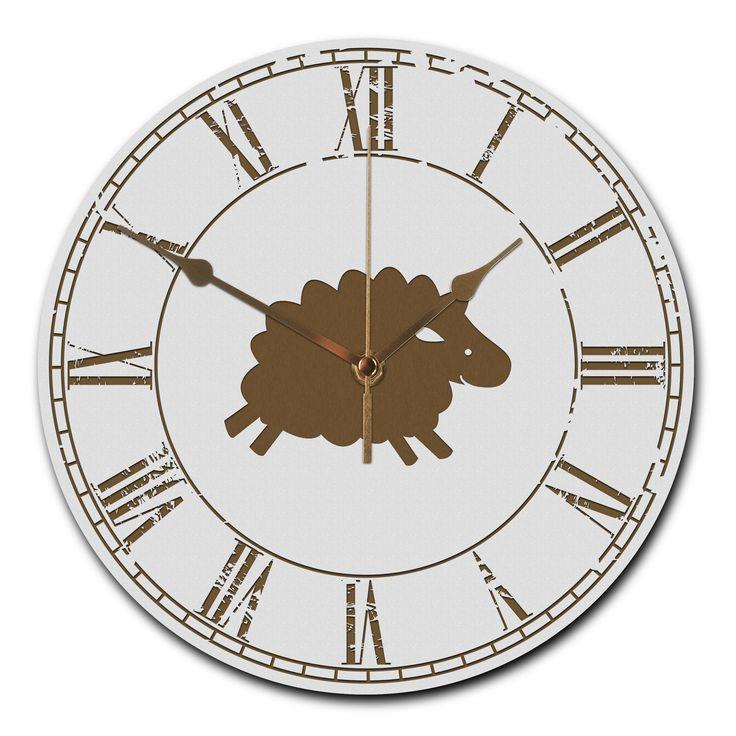 Wanduhr rund Schaf aus MDF  Weiß - Das Original von Mr. & Mrs. Panda.  Eine wunderschöne runde Wanduhr aus hochwertigem MDF Holz mit goldenen Zeigern und absolut lautlosem Uhrwerk    Über unser Motiv Schaf  Schafe gehören zu den ältesten Haustieren der Welt und sind für ihre flauschige Wolle bekannt. Schafe und ihre Lämmer sehen durch ihre Wolllöckchen unglaublich niedlich aus und es macht immer gute Laune, sie über die Wiesen tollen zu sehen. Das süße wollende Schaf ist nicht nur ein tolles…