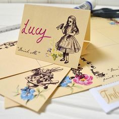 Truly Alice - Free Printable  Placecards Simply print and cut-out to create your own Alice in Wonderland place cards. Write each of your Truly Alice guests names and lay the table!  Top Tip: Back with card for a sturdier finish. Note that these PDF downloads are formatted for UK paper and envelope sizes Free download for you to enjoy... just add to your cart and we will email you the PDF file for you to print at home or Click on link on our site to get your free downloadable PDF