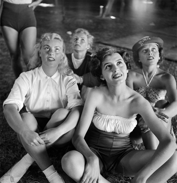 A picture of a group of circus girls sitting at a rehearsal for the Ringling Bros. and Barnum & Bailey Circus in Sarasota, FL in 1949.