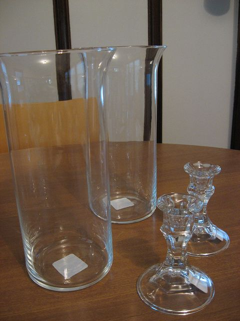 Dollar store glassware makes great hurricane candle holders.  These look great.