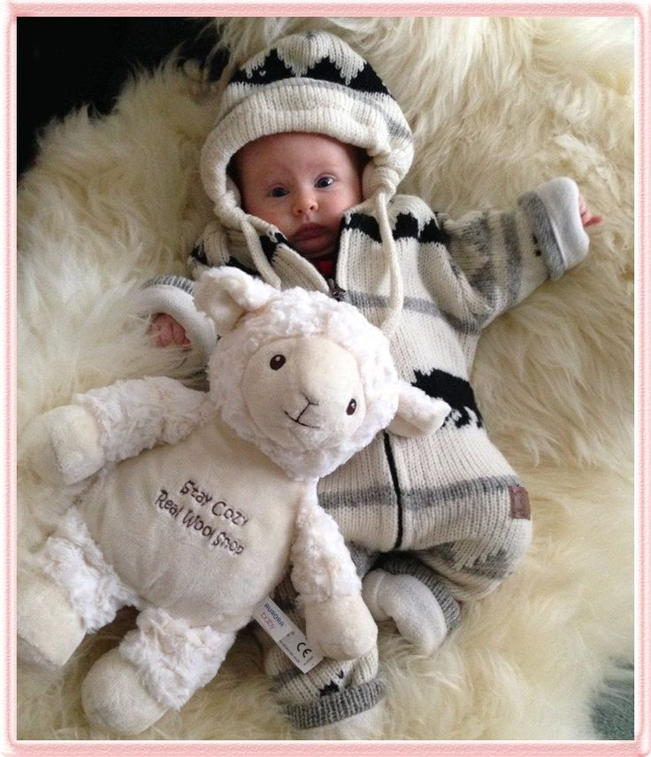 Baby on Lambskin rug with lamb toy
