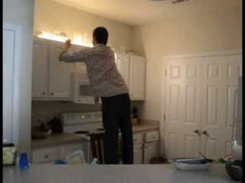Over Cabinet Lighting in One Easy Step: Tom from Pegasus Lighting improves the lighting in his rental's kitchen with LED over cabinet lights. In fact, it took him all of one minute to dramatically improve his kitchen using an LED tape/rope hybrid.  http://www.pegasuslighting.com/led-flexible-tape-rope-light-kits-wet-location-120v-high-output.html.