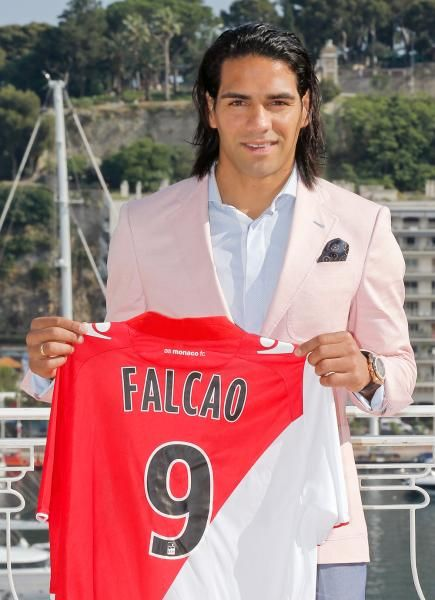 Soccer player Radamel Falcao of Colombia holds up his new shirt during his official presentation after signing for AS Monaco, Tuesday, July 9, 2013, in Monaco. (Lionel Cironneau/AP)