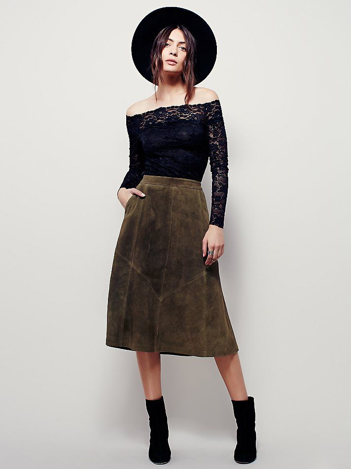 Geometry Lesson Suede Skirt | Super luxe suede skirt in an A-line silhouette with hip pockets.  Hidden zip in back with a button closure.  Lined.