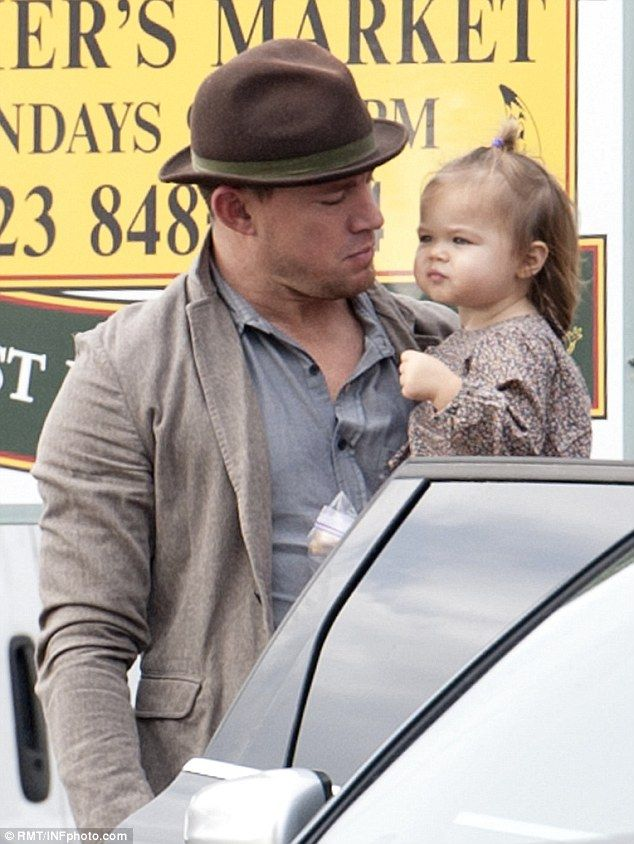 Proud dad: Channing gazed at his young daughter as she took in her surroundings...