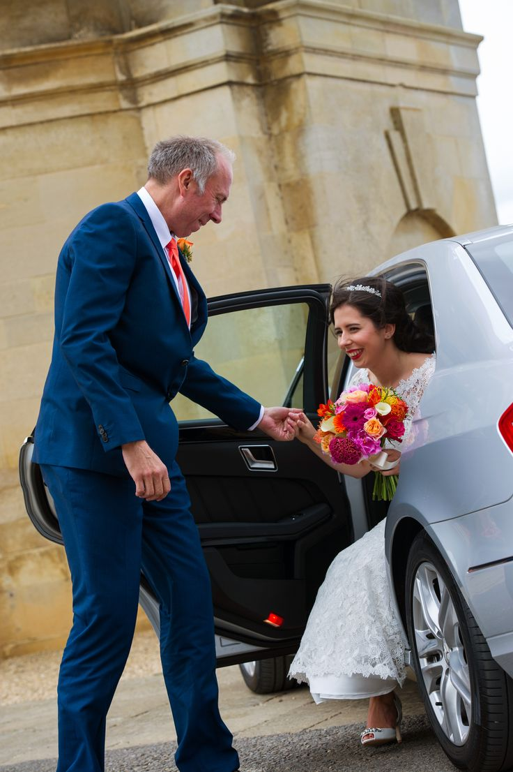 Lovely shot of Dad helping his Daughter out the car. Bride, Father of the Bride, Rutland Water Church, Rutland, Wedding photography