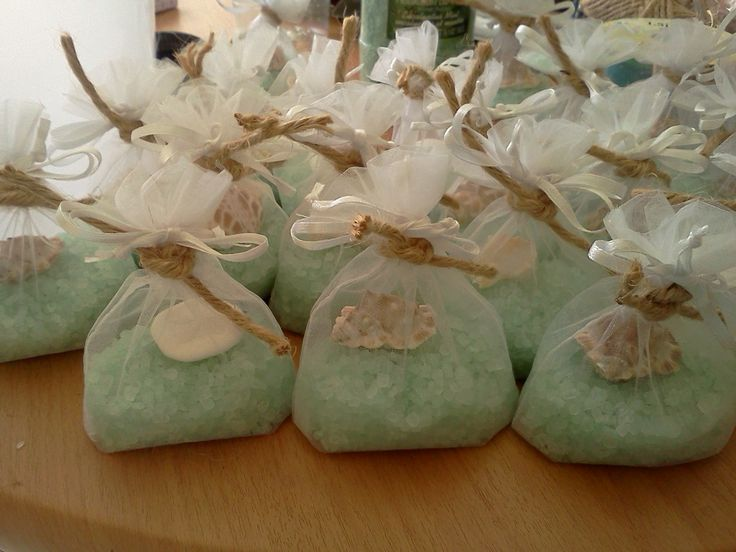 bath salts and one small seashell or sanddollar in mesh bags tied with twine and pretty ribbons. gave away as party favor at mermaid under the sea baby shower and at a surfside wedding reception. lil tip...store in an air tight container until your party so they dont loose their fragrance ( i used an old ice cream tub and it has a handle so i could carry them to the party)